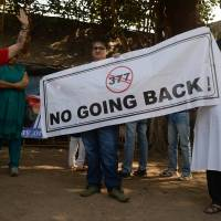 Reversal: Indian activists hold a banner during a protest Wednesday in Mumbai over the Supreme Court ruling reinstating a ban on gay sex. | AFP-JIJI