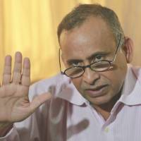 Incensed: Uttam Khobragade, the father of diplomat Devyani Khobragade, who was arrested and strip-searched in New York, speaks at a news conference in Mumbai on Thursday. | AP