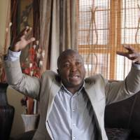 Visionary: Thamsanqa Jantjie gives an interview in Johannesburg on Thursday. He said he saw 'angels' as he was providing sign-language interpretation for U.S. President Barack Obama and other world leaders at Nelson Mandela's memorial in Soweto. | AP