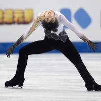 Eye on the prize: Yuzuru Hanyu performs during the men's free skate on Friday at the Grand Prix Final in Fukuoka. Hanyu claimed the gold medal with 293.25 points.    AFP-JIJI