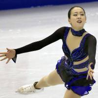 Another crowning achievement: Mao Asada performs during the free skate on Saturday at the Grand Prix Final in Fukuoka. Mao collected the gold medal with 204.02 points, tying Russia's Irina Slutskaya's record of four Grand Prix Final victories. | KYODO