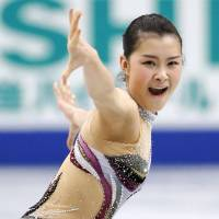 Stirring performance: Kanako Murakami excites the crowd while skating to 'Violin Muse' on Sunday in the short program at nationals at Saitama Super Arena. Murakami sits in third place heading into the free skate. | KYODO