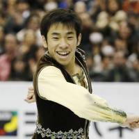 Solid effort: Nobunari Oda earns a third-place finish in the men's competition at the Grand Prix Final. | AP