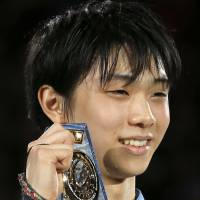 Proud moment: Yuzuru Hanyu displays his gold medal at the Grand Prix Final in Fukuoka.   | AP