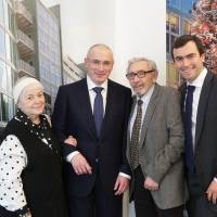 Reunited: Russian former oil tycoon Mikhail Khodorkovsky (second from left) stands next to his mother, Marina Khodorkovsky, his father Boris Khodorkovsky and his son Pavel Khodorkovsky at the Wall Museum at Checkpoint Charlie on Sunday in Berlin. | AFP-JIJI