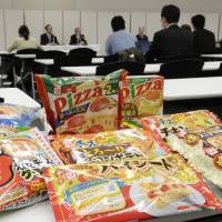 Under suspicion: Samples of frozen foods being recalled by Aqlifoods Co., a subsidiary of Maruha Nichiro Holdings Inc., are displayed at a press conference in Tokyo.   KYODO