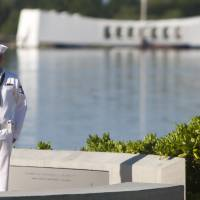 In memory: With the USS Arizona in the background, a Navy rifleman stands at attention at the ceremony commemorating the 72nd anniversary of the attack on Pearl Harbor on Saturday in Honolulu. | AP