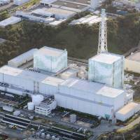 Defunct by default: Reactors 5 and 6 at Tokyo Electric Power Co.'s Fukushima No. 1 nuclear plant, as seen in September, will be permanently shut down, Tepco said Wednesday. The two units didn't suffer major damage in the March 11, 2011, disaster. | KYODO
