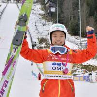 Reason to smile: Sara Takanashi leads the World Cup circuit with a perfect 300 points.   KYODO