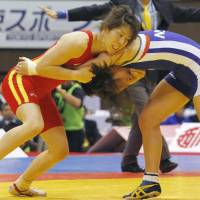 Still the best: Saori Yoshida (left) wins her 11th 55-kg title at nationals on Monday. | KYODO