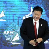 Bun of the people: Chinese President Xi Jinping arrives for a session of the Asia-Pacific Economic Cooperation summit Oct. 7 in Bali, Indonesia. On Saturday, Xi was seen in less humble surroundings as he dropped by a traditional, no-frills Beijing bun shop for a snack. | BLOOMBERG