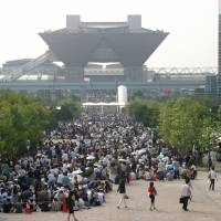 Festival atmosphere: Hordes of manga fans line up to attend Comiket at Tokyo Big Sight. One of the many attractions at the event is the cosplay area, where girls  and boys dress up as anime characters. | COMIC MARKET COMMITTEE