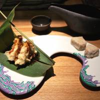 Psychedelicious: GiroGiro's playful spirit is evident in its new Tokyo branch, with unusual dishes including foie gras and battered lotus root on a bamboo-grass leaf. | ROBBIE SWINNERTON