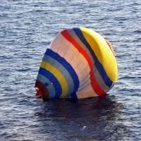 Flying solo: A photo provided by the Japan Coast Guard on Jan. 1, 2014, shows the hot air balloon that a Chinese man had attempted to land on the disputed Senkaku Islands.  | AFP PHOTO / JAPAN COAST GUARD