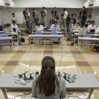 Shame remains: A woman born out of wedlock speaks on Sept. 4 in  Wakayama city about the Supreme Court ruling earlier in the day that declared discrimination against children born to unmarried parents in inheritance cases to be unconstitutional.   KYODO