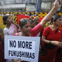 Activists in Mumbai protest in October 2013 against plans to build a nuclear power plant in Maharashtra state. | AP