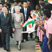 Emperor Akihito and Empress Michiko leave a welfare association in Chennai during a rare state visit on Dec. 5. | KYODO