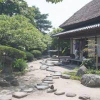 Home sweet home: Visitors to the Ohara Residence admire its small but fine Edo Period garden. | STEPHEN MANSFIELD PHOTO