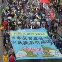 An estimated 11,100 people take part in a pro-democracy   march in Hong Kong on Wednesday. | Kyodo