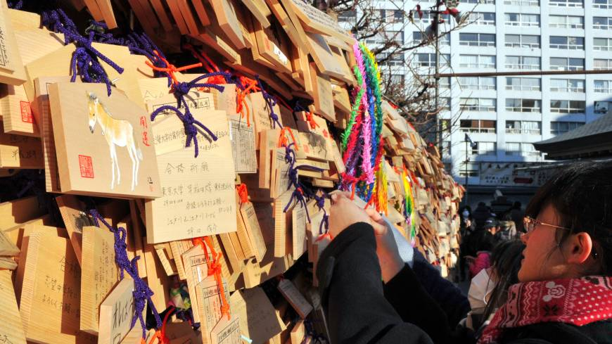 'Ema' (traditional Shinto plaques) displaying the hand-written messages and wishes of visitors are hung outside Yushima Tenjin Shrine in Tokyo's Bunkyo Ward. In the Chinese zodiac, 2014 is a year associated with the horse.  | YOSHIAKI MIURA