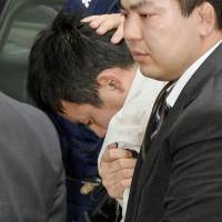 Suspect rape suspect Yuta Sugimoto is taken into custody after being captured by police at a park near Yokohama.   AP