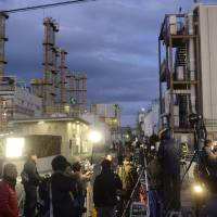 Media crews gather outside Mitsubishi Materials Corp.'s Yokkaichi plant Thursday, where an explosion killed at least five workers.  | KYODO