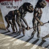 Evolution: Graffiti in Beirut depicts mankind moving from primate to suicide bomber. | AFP-JIJI