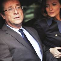 Wrong horse?: Francois Hollande and his partner, Valerie Trierweiler, leave a polling station in Tulle after voting in the first round of the French presidential election in April 2012. | AFP-JIJI