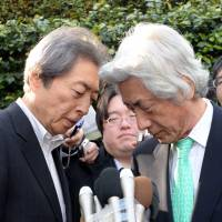 Common cause: Former Prime Ministers Morihiro Hosokawa (left) and Junichiro Koizumi speak to reporters after meeting in Tokyo on Tuesday. | AFP-JIJI
