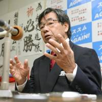 Man of the hour: Mayor Susumu Inamine attends a press conference on Monday, a day after winning his second term in Nago, Okinawa Prefecture. | KYODO