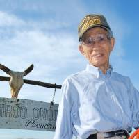 Riding high: Hiroo Onoda is shown atop a horse at his ranch in Campo Grande, Brazil, in 2012 next to his wife, Machie. | KYODO