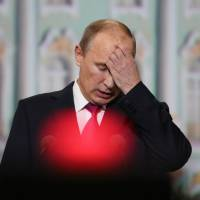 Country of contrasts: Russian President Vladimir Putin speaks during an economic conference held in St. Petersburg in June. Despite massive investment, Putin is facing criticism for failing to provide even basic services to residents of Sochi, host of the 2014 Winter Olympics. | BLOOMBERG