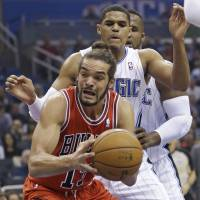 Full shift: Chicago's Joakim Noah looks to shoot during the Bulls' 128-125 triple-overtime win over the Magic on Wednesday. | AP