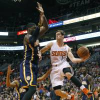 Rising sun: Phoenix's Goran Dragic tries to pass around Indiana's Roy Hibbert during the Suns' 124-100 win on Wednesday. | AP