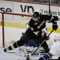 Cloud nine: Anaheim's Corey Perry controls the puck during the Ducks' 9-1 win over the Canucks on Wednesday. | AP