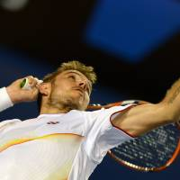 Here it comes: Stanislas Wawrinka serves to Tomas Berdych during their semifinal match at the Australian Open on Thursday. | AFP-JIJI