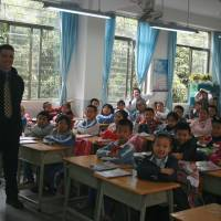 Packed to the brim: Jason Ricciardi poses for a picture with one of his third-grade classes of 57 Chinese students at Liutang Elementary School in Shenzhen, Guangdong Province. | XIANG JIAN
