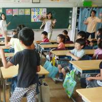 Easy as A-B-C: An English class is held for a third-grade class at an elementary school in Tokyo's Shinagawa Ward. | KYODO