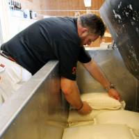 In the drink: Nøgne Ø co-founder Kjetil Jikiun presses a sake at his brewery in Grimstad, Norway, which also makes beer.