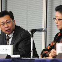 Lam answers a question from the audience during a symposium, titled 'Myanmar now; Myanmar's recent moves and its relationship with Japan viewed from Southeast Asia,' organized by the Keizai Koho Center in Tokyo on Dec. 9. | SATOKO KAWASAKI