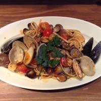 Trattoria Tsukiji Paradiso's signature dish comes topped with clams and mussels. | YUKARI SAKAMOTO