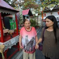 Getting away from it: Swiss Alzheimer's patients engage with their Thai caretakers at Chiang Mai's Baan Kamlangchay, where treatment can cost significantly less than in their home countries. | AP