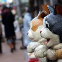A whisker's difference: Yanaka, part of a wider area of eastern Tokyo known as Yanesen, is lorded over by its population of wandering cats — a sure indication that its residents embrace a gentler lifestyle than in other parts of the capital. | WIKIMEDIA COMMONS