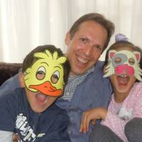 Wild on the web: Adam Beck at his Hiroshima home with his two children, on whom the two simian stars of the Bilingual Monkeys website are based. | COURTESY OF ADAM BECK