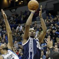 Filling it up: Oklahoma City's Kevin Durant puts up a jumper over Minnesota's Corey Brewer in the second half on Saturday night. The Thunder downed the Timberwolves 115-111. | AP