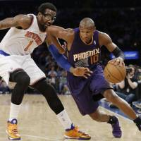 Making his move: Phoenix's Leandro Barbosa drives around New York's Amare Stoudemire in the second half on Monday night. | AP
