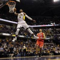 Elevation: Indiana's Paul George throws down a massive dunk against Los Angeles in the second half on Saturday night. The Pacers beat the Clippers 106-92. | AP