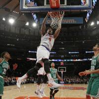 Busting loose: New York's Jeremy Tyler dunks against Boston in the second half on Tuesday night at Madison Square Garden. The Knicks routed the Celtics 114-88. | AP