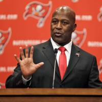 Big plans: Lovie Smith speaks at a news conference in Tampa, Florida, on Monday after being introduced as the new head coach of the Buccaneers.   AP