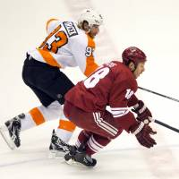 Going for it: Phoenix's David Moss (right) and Philadelphia's Jacob Voracek vie for the puck on Tuesday. The Coyotes won 6-0. | AP